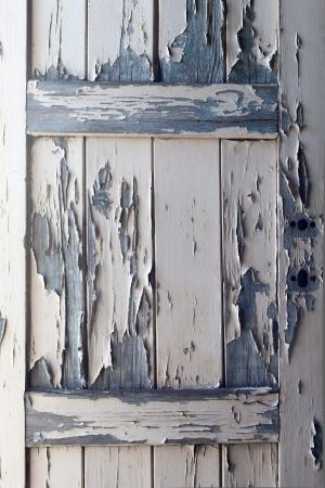 Peeling Paint on old wooden door, texture background photo