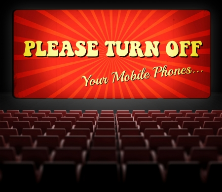 silent film: Please turn off cell phones movie screen concept in old retro cinema