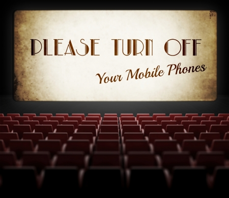 Please turn off cell phones movie screen concept in old retro cinema photo
