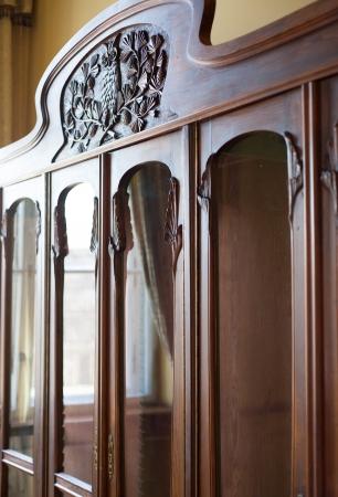 Retro wooden cabinet, old furniture in classic interior photo
