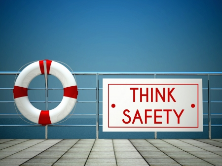 Think Safety sign at the swimming pool with lifebuoy Stock Photo