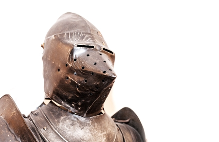 Vintage knights armor suit on white background photo