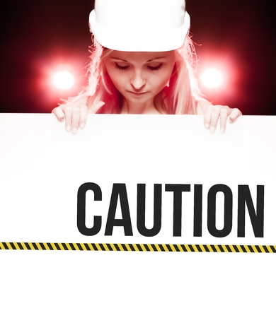 Caution sign held by a worker photo