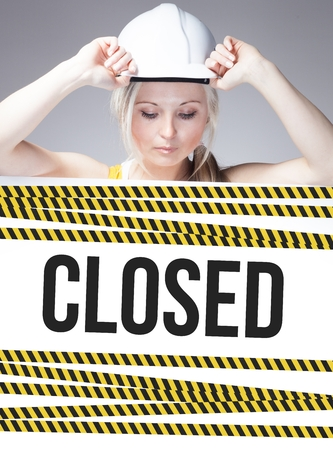 overhaul: Closed sign on information poster and worker woman