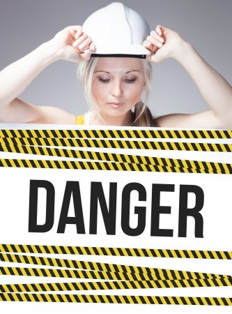overhaul: Danger sign on information poster and worker woman