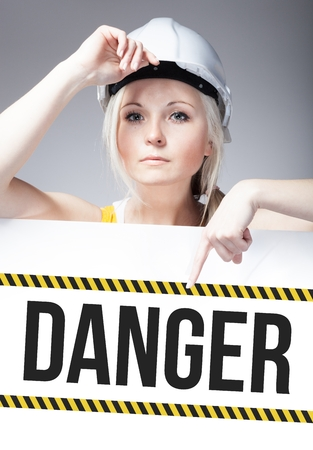 Danger sign on template board with worker woman photo