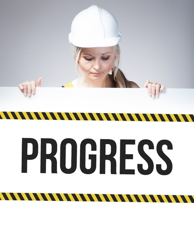 Progress sign on information poster and worker woman photo