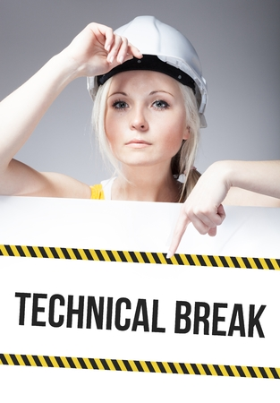 Technical break sign on template board with worker woman photo
