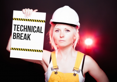 overhaul: Technical break placed on information board and worker woman
