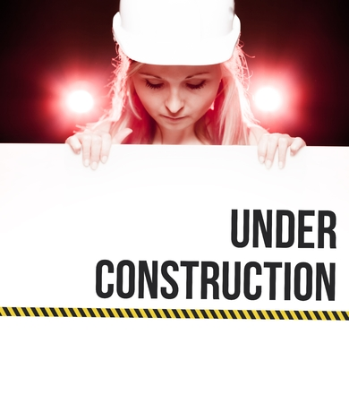 overhaul: Under construction sign held by a worker Stock Photo