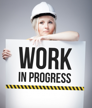 overhaul: Work in progress sign on information poster and worker woman
