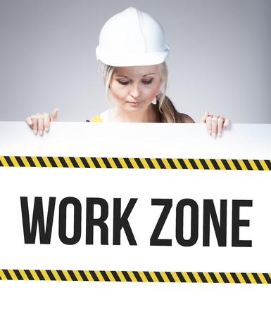 mujer trabajadora: Muestra de la zona de trabajo sobre carteles de informaci�n y de la mujer trabajadora Foto de archivo