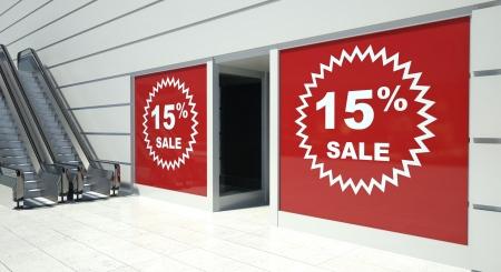 sell off: 15 percent sale on shopfront windows and escalators