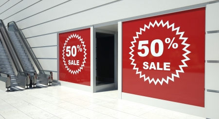 shopfront: 50 percent sale on shopfront windows and escalators Stock Photo
