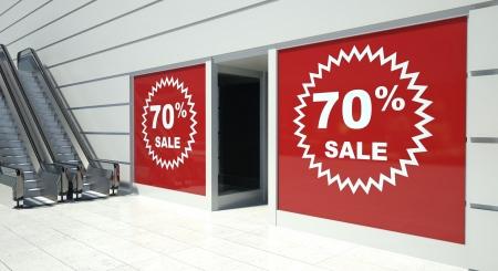 shopfront: 70 percent sale on shopfront windows and escalators Stock Photo