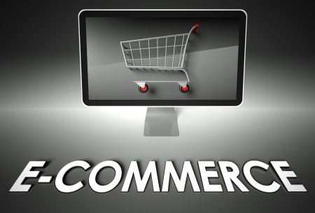 ebuy: Computer screen and shopping cart with word E-commerce, Business concept