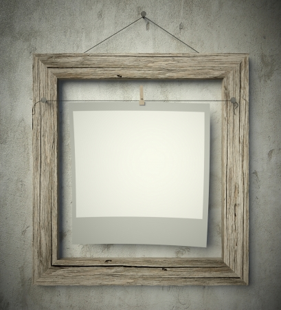 Empty old frame with blank photo on wall, vintage background photo