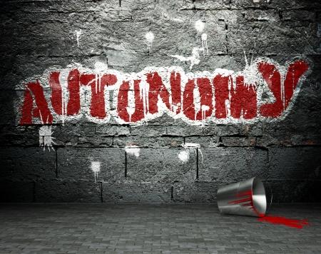 autonomia: Pared de la pintada con la autonomía, arte de la calle de fondo Foto de archivo