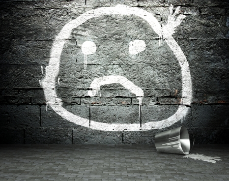 Graffiti wall with sad face, street art background