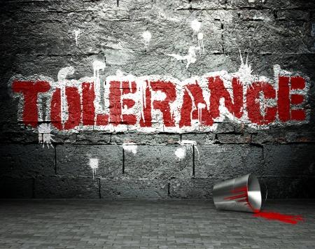tolerance: Pared de la pintada con la tolerancia, el arte de la calle de fondo Foto de archivo
