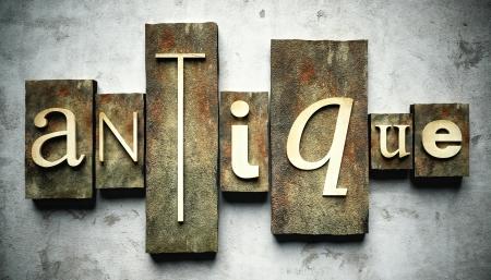 Antique concept, retro vintage letterpress type on grunge background photo