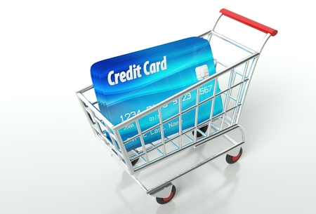 Credit card payment with shopping cart, concept photo