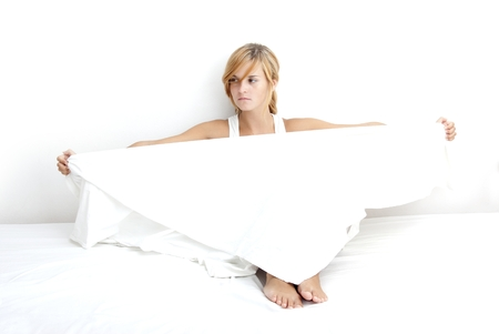 bedsheet: Innocent young girl in a white linen