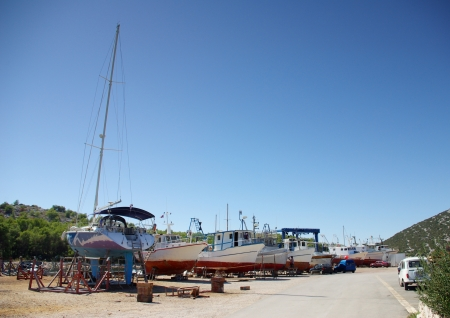 Ship repair on the ground in shipyard or harbor, Croatia Dalmatia Tribunj