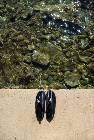 swimming shoes: Swimming or surfing shoes on beach