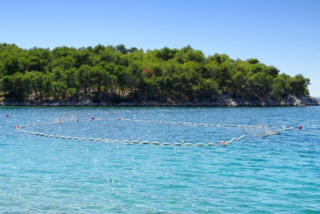 Water polo goals and beach by the sea, Croatia Dalmatia Tribunj photo