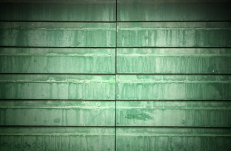 Wet green metal gate, texture  photo