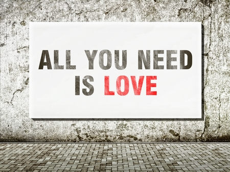 All you need is love, words on old wall photo
