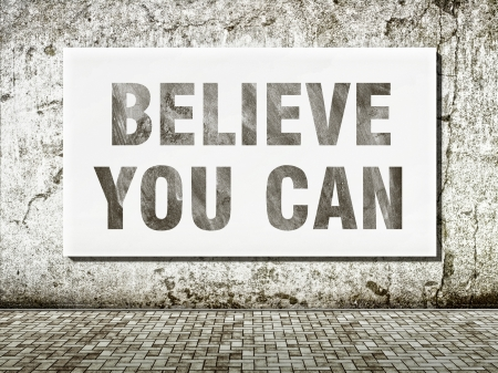 Believe you can, words on wall in vintage style photo