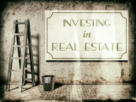 Investing in real estate on wall in vintage style photo