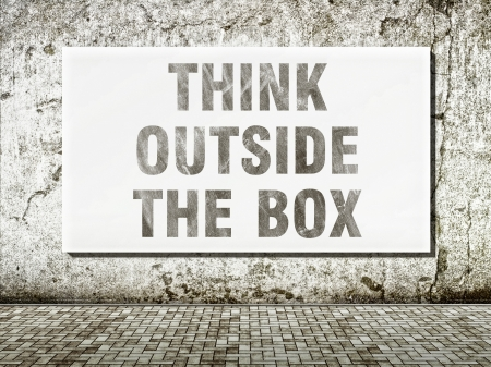 Think outside the box, words on old wall photo