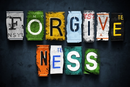 Forgiveness word on vintage broken car license plates Stock Photo
