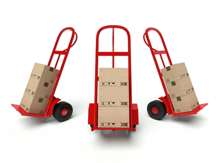 Three warehouse hand trucks with cardboard boxes isolated on white background photo