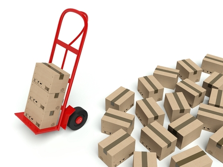 Warehouse hand truck and many cardboard boxes on the ground photo