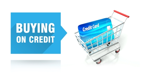 Buying on credit card concept with shopping cart Stock Photo - 26323321