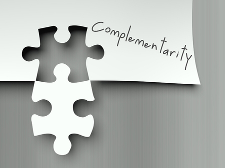 Complementarity concept with matching puzzle pieces photo