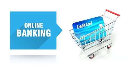 Online banking concept with credit card and shopping cart photo