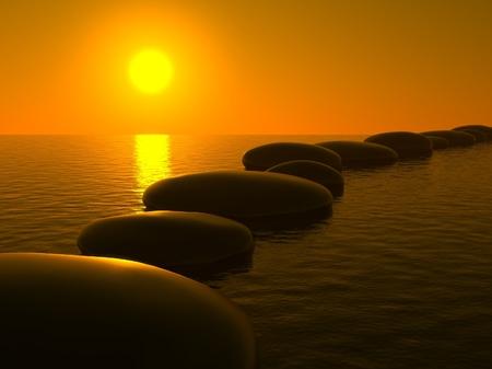 Zen stones in water and sunset