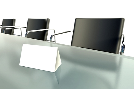 Conference table and blank place card on white background photo