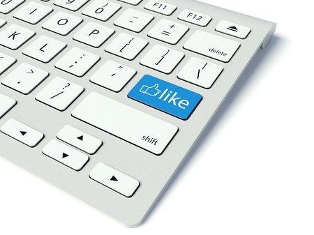 Keyboard with blue Like button, social network concept photo