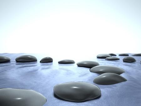 Zen stones in water and blue sky Stock Photo