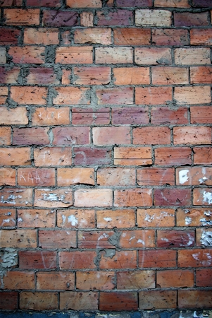 uncoated: Bricks wall scratched with cement, texture Stock Photo