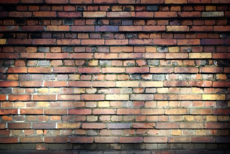 uncoated: Old brick wall, texture with beams of light Stock Photo