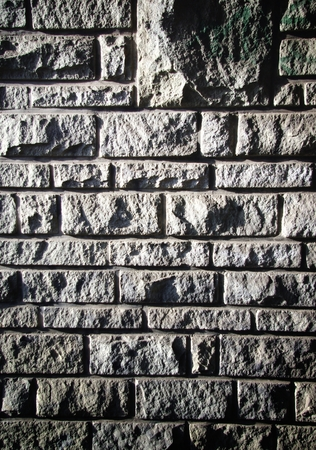 uncoated: Old stone bricks wall pattern, texture with deep shadows