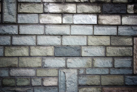 uncoated: Stone bricks wall pattern, texture with deep shadows Stock Photo