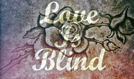 Love is Blind message on stone rose background photo